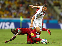 Miroslav Klose of Germany and Kwadwo Asamoah of Ghana in action