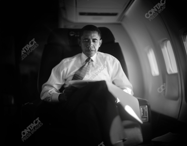 Senator Barack Obama (D-IL), Democratic candidate for president, on board his plane en route to Missouri, where he will campaign in St. Louis and Kansas City. October 18, 2008.