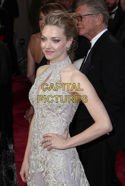 Amanda Seyfried (wearing Alexander McQueen).85th Annual Academy Awards held at the Dolby Theatre at Hollywood & Highland Center, Hollywood, California, USA..February 24th, 2013.oscars half length dress hand on hip embellished high collar keyhole bust cut out lilac purple sheer gold embroidered print sleeveless .CAP/ADM/SLP/COL.©Colin/StarlitePics/AdMedia/Capital Pictures