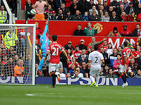 Pictured: Swansea goalkeeper Lukasz Fabianski (L) saves the ball from a Wayne Rooney free kick. Saturday 16 August 2014<br /> Re: Premier League Manchester United v Swansea City FC at the Old Trafford, Manchester, UK.