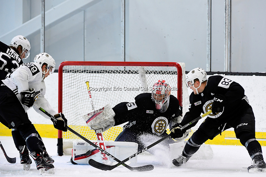 June 28, 2018: Boston Bruins goalie Kyle Kyser (85) makes a save as teammates defenseman Lucas Ekestahljonsson and Boston Bruins forward Karson Kuhlman (83) look for the rebound during the Boston Bruins development camp held at Warrior Ice Arena in Brighton Mass. Eric Canha/CSM