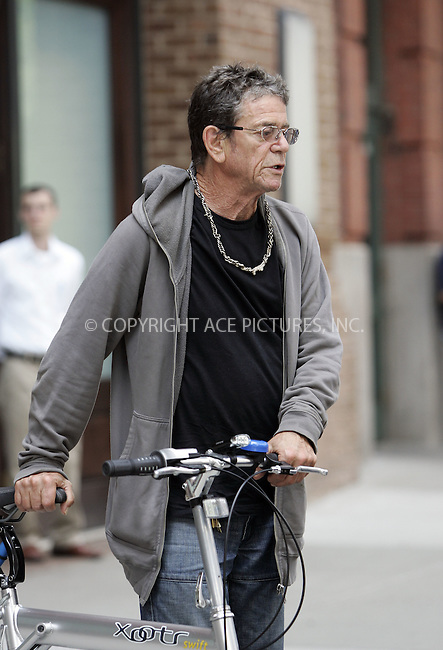 WWW.ACEPIXS.COM . . . . .  ....Exclusive - all rounder....June 28 2011, New York City....Wrinkly rock legend Lou Reed goes green with his bicycle in downtown Manhattan on June 28 2011 in New York City....Please byline: CURTIS MEANS - ACE PICTURES.... *** ***..Ace Pictures, Inc:  ..Philip Vaughan (212) 243-8787 or (646) 679 0430..e-mail: info@acepixs.com..web: http://www.acepixs.com
