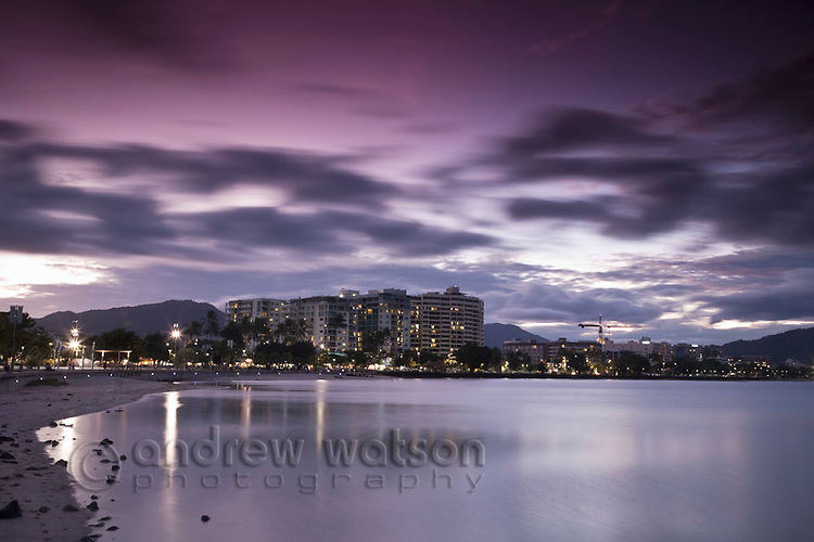 View of the Esplanade and city skyline at dusk.  Cairns, Queensland, Australia