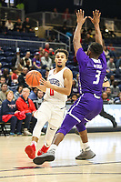 Washington, DC - December 22, 2018: Richmond Spiders guard Jacob Gilyard (0) is being defended by High Point Panthers guard Jamal Wright (3) during the DC Hoops Fest between Hampton and Howard at  Entertainment and Sports Arena in Washington, DC.   (Photo by Elliott Brown/Media Images International)