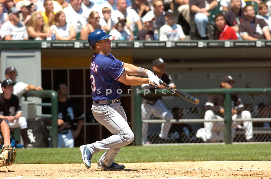 Mark Teixeira in action during the Texas Rangers v. Chicago White Sox game on June 4, 2006. ..Rangers win 10-2..Chris Bernacchi / SportPics
