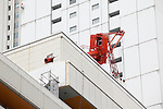 March 11, 2011, Tokyo, Japan - A crane topples on the roof of a building with a part breaking the wall in Tokyo's Ikebukuro area following a severe earthquake that struck Japan's northeastern prefectures on Friday, March 11, 2011. Hundreds of people are feared dead after the country's biggest earthquake with a magnitude of 8.9 since records began struck the northeastern coasts, unleashing a 10-metre tsunami that swept away buildings, ships and vehicles. (Photo by AFLO) [3609] -mis-