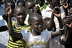 Children link hands as they sing during an outdoor Mass in Christ the King Catholic parish in Malakal, Southern Sudan, on November 21, 2010. NOTE: In July 2011 Southern Sudan became the independent country of South Sudan.