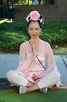 Beautiful Asian Woman Meditating, Seafair Torchlight Parade, Seattle, WA, USA.