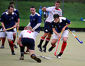 Hockey - Subway Eat Fresh Mens National League Div 1 - Western Wildcats V Menzieshill at Auchenhowie, Milngavie - Menzieshill's Jamie Brown steals the ball away, as Wildcats (in white) press home an attack in their 6-1 victory - Picture by Donald MacLeod 05.09.09