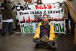 Amber Bockman a  protestor takes part in the March in March outside the TVA headquarters in Knoxville, Tennessee. The protestors were protesting coal mining during an event called Mountain Justice Spring Break on March 14, 2009.