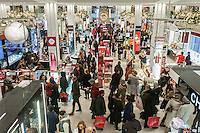 "Hordes of shoppers in the Macy's Herald Square flagship store in New York looking for bargains on the day after Thanksgiving, Black Friday, November 28, 2014. Many retailers, including Macy's, opened their doors on Thanksgiving evening extending the shopping day and giving Thanksgiving the nickname ""Gray Thursday"". (© Richard B. Levine)"