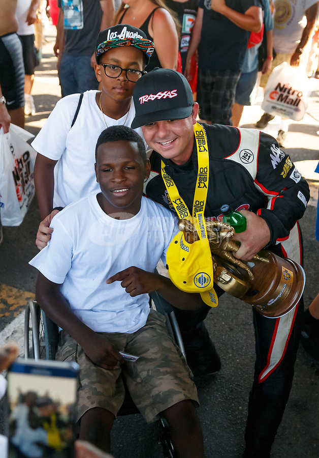 Jun 11, 2017; Englishtown , NJ, USA; NHRA top fuel driver Steve Torrence celebrates with fans after winning the Summernationals at Old Bridge Township Raceway Park. Mandatory Credit: Mark J. Rebilas-USA TODAY Sports