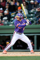 Center fielder Tyler Slaton (18) of the Clemson Tigers bats in the Reedy River Rivalry game against the South Carolina Gamecocks on Saturday, February 28, 2015, at Fluor Field at the West End in Greenville, South Carolina. South Carolina won, 4-1. (Tom Priddy/Four Seam Images)