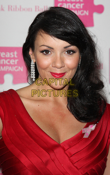 MARTINE McCUTCHEON .Attending the Pink Ribbon Ball at the Dorchester Hotel, Park Lane, London, England, UK, October 10th 2009..portrait headshot lipstick make-up earrings dangly red pleated tiered  ruffles ruffle .CAP/ROS.©Steve Ross/Capital Pictures.