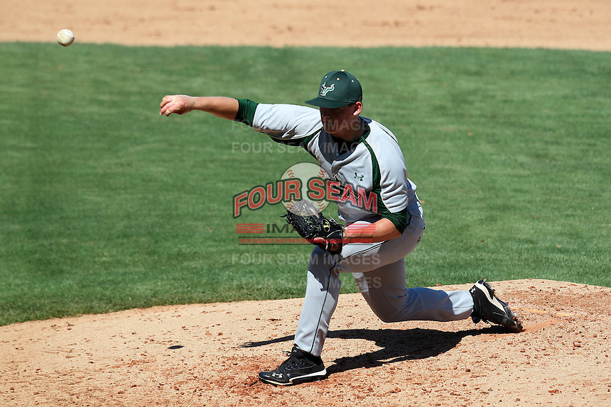 USF Bulls pitcher Michael Clarkson #24 delivers a pitch during a scrimmage against the New York Yankees at Steinbrenner Field on March 2, 2012 in Tampa, Florida.  New York defeated South Florida 11-0.  (Mike Janes/Four Seam Images)