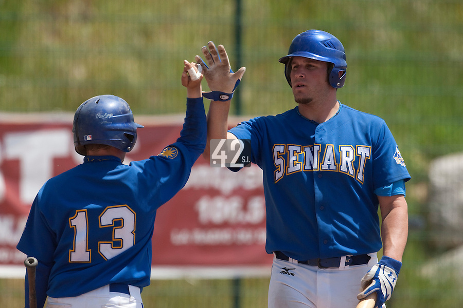 24 May 2009: Rhett Teller of Senart is congratulated by Damien Teygeman during the 2009 challenge de France, a tournament with the best French baseball teams - all eight elite league clubs - to determine a spot in the European Cup next year, at Montpellier, France. Senart wins 8-5 over La Guerche.