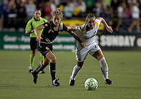 Kimberly Yokers (left) and Camille Abily (right) chase down the ball. LA Sol and FC Gold Pride tied 0-0 at Buck Shaw Stadium in Santa Clara, California on July 23, 2009.