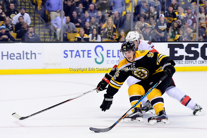 April 23, 2017: Boston Bruins center Noel Acciari (55) shields the puck from Ottawa Senators defenseman Dion Phaneuf (2) during the game 6 of the National Hockey League Eastern Conference quarterfinal Stanley Cup playoff between the Ottawa Senators and the Boston Bruins held at TD Garden, in Boston, Mass. Ottawa eliminates Boston 3-2 in overtime taking the series 4 games to 2. Eric Canha/CSM