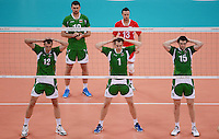 12.08.2012. London, England. Bulgarian Players relax their arms at the net during the mens  Volleyball Bronze Medal Match between Bulgaria and Italy London 2012 Olympic Games Italy Won 3 1