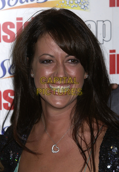 SHEREE MURPHY .Inside Soap Awards Party, La Rascasse, Cafe Grand Prix, London, September 27th 2004..portrait headshot siver tiffany heart necklace fringe sheer green low cut top black sequined cardigan.Ref: PL.www.capitalpictures.com.sales@capitalpictures.com.©Capital Pictures.