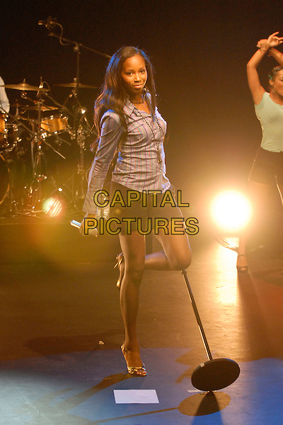 JAMELIA.Performing at The Hospital, Covent Garden, London, UK..August 23rd, 2006.Ref: DH.stage concert live gig performance music black shorts blue stripes striped shirt full length  .www.capitalpictures.com.sales@capitalpictures.com.©David Hitchens/Capital Pictures.