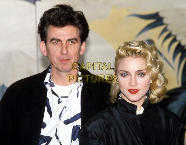 MADONNA & GEORGE HARRISON..Ref: 026 ..peroxide blonde hair, red lipstick, black high collared coat, ex beatle, headshot, portrait..www.capitalpictures.com..sales@capitalpictures.com..©Capital Pictures