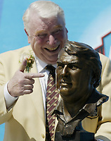 John Madden, coach of the Oakland Raiders for 10 seasons, jokes while posing with his bust during the Pro Football Hall of Fame induction ceremony Saturday, Aug. 5, 2006, in Canton, Ohio.<br />