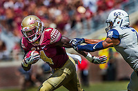 TALLAHASSEE, FLA 9/10/16-Florida State's Dalvin Cook proves elusive for Charleston Southern's Troy McGowens while on a 13-yard run during first quarter action Saturday at Doak Campbell Stadium in Tallahassee. <br /> COLIN HACKLEY PHOTO