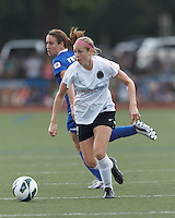 Portland Thorns FC defender Nikki Marshall (7) on the attack.  In a National Women's Soccer League (NWSL) match, Portland Thorns FC (white/black) defeated Boston Breakers (blue), 2-1, at Dilboy Stadium on July 21, 2013.