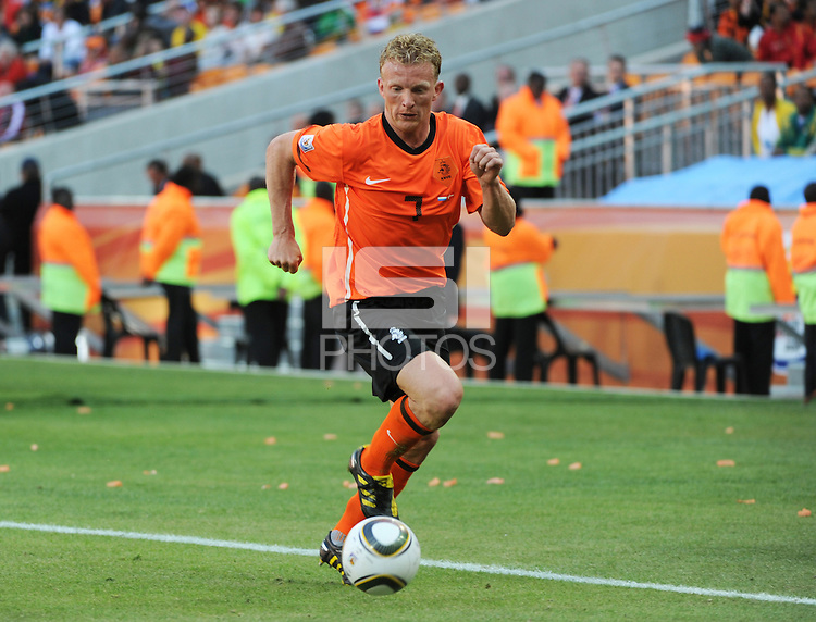 Dirk Kuyt dribbles the left flank. Holland defeated Denmark, 2-0, June 14th, at Soccer City in the opening match of Group E of the 2010 FIFA World Cup.