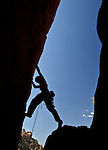 "Pat Winstanley begins leading the 5.11""Devils Advocate"" route in Upper Devils Canyon near Superior, Arizona."