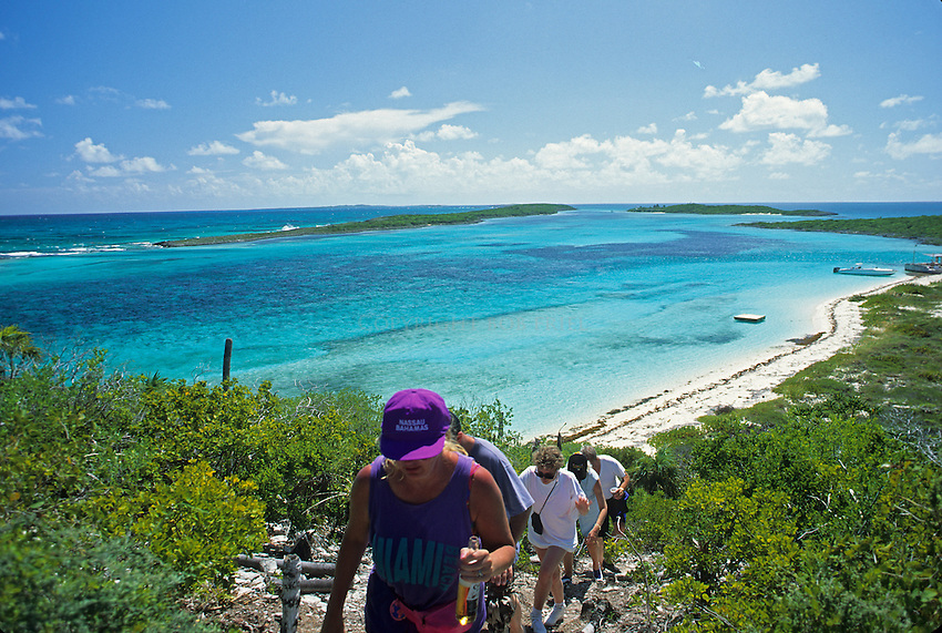 Group hikes up a hill on Ship Channel Cay in the Exumas