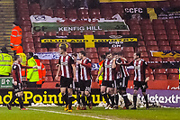 Sheffield United players congratulate scorer Leon Clarke during the Sky Bet Championship match between Sheff United and Cardiff City at Bramall Lane, Sheffield, England on 2 April 2018. Photo by Stephen Buckley / PRiME Media Images.