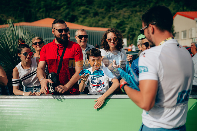 Publicity caravan hands out goodies at the end of Stage 15 of the 2019 Tour de France running 185km from Limoux to Foix Prat d'Albis, France. 20th July 2019.<br /> Picture: ASO/Thomas Maheux | Cyclefile<br /> All photos usage must carry mandatory copyright credit (© Cyclefile | ASO/Thomas Maheux)
