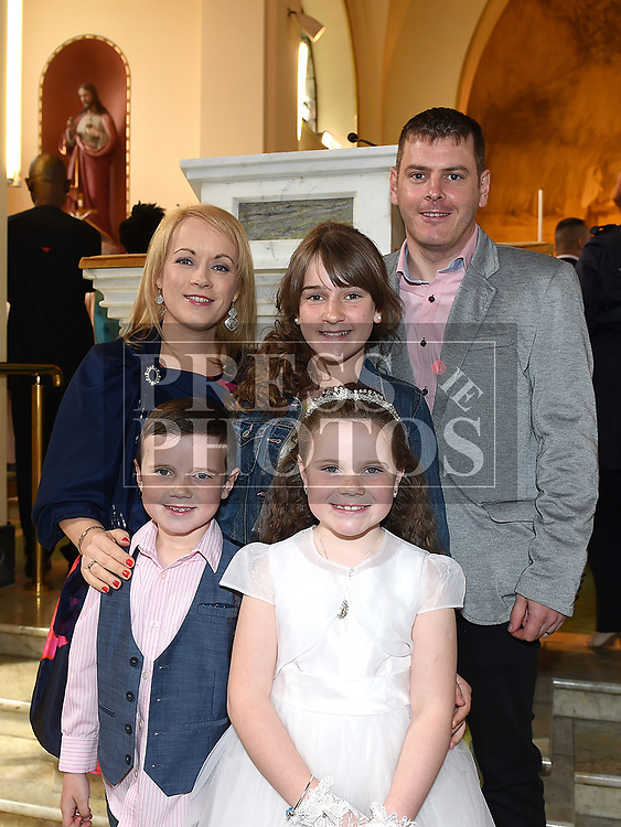 Jena Kearney from St Brigids school who recieved first holy communion in Our Lady of Lourdes church with parents Glenn and Lisa, sister Erin and brother Adam. Photo:Colin Bell/pressphotos.ie