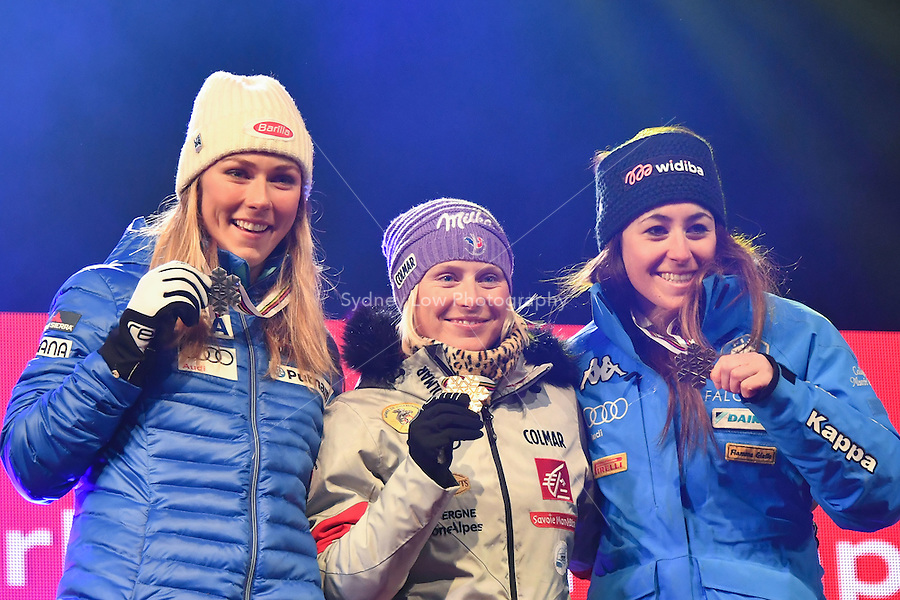 February 16, 2017: Mikaela SHIFFRIN (USA) (2nd), Tessa WORLEY (FRA) (1st) and Sofia GOGGIA (ITA) (3rd) pose for photographs at the medal ceremony for the women's giant slalom event of the FIS Alpine World Ski Championships at St Moritz, Switzerland. Photo Sydney Low