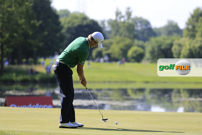 Tom Lewis (ENG) takes his putt on the 16th green during Thursday's Round 1 of the 2013 BMW International Open held on the Eichenried Golf Club, Munich, Germany. 20th June 2013<br /> (Picture: Eoin Clarke www.golffile.ie)