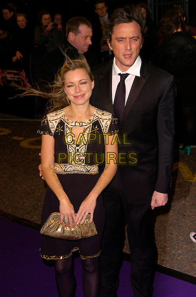 SARAH ALEXANDER & PETER SERAFINOWICZ.British Comedy Awards 2007, London Studios, South Bank, London, England. .December 5th 2007.half length black dress white gold trim 3/4 sequins sequined clutch bag purse windy messy hair suit couple.CAP/CAN.©Can Nguyen/Capital Pictures