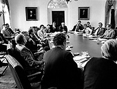 "United States President Jimmy Carter and his cabinet discuss the energy program at a cabinet meeting in the Cabinet Room of the White House in Washington, DC on April 18, 1977.  The President is scheduled to deliver energy address to the nation on live television in the evening.  In his remarks, the President will equate the energy crisis as the ""moral equivalent of war.""<br /> Credit: White House via CNP"