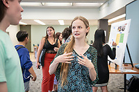 "Caroline Arnall presents, ""Evaluation of a Hypervalent Iodine-Mediated Oxidative Rearrangement of Phenols""<br /> Mentor: Raul Navarro, Chemistry<br /> Occidental College's Undergraduate Research Center hosts their annual Summer Undergraduate Research Conference on July 31, 2019. Student researchers presented their work as either oral or poster presentations at this final conference. The program lasts 10 weeks and involves independent research in all departments.<br /> (Photo by Marc Campos, Occidental College Photographer)"
