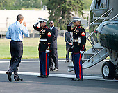 United States President Barack Obama salutes two Marine Guards as he departs Walter Reed National Military Medical Center in Bethesda, Maryland on Tuesday, July 29, 2014 following a visit to wounded service members.  Earlier in the day, the President made a statement at the White House concerning additional sanctions on Russia for their involvement in Ukraine.  <br /> Credit: Ron Sachs / Pool via CNP