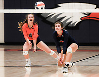 NWA Democrat-Gazette/CHARLIE KAIJO Rogers Heritage High School Kyndall Strickland (3) and Brittney Ware (4) set during a volleyball game, Thursday, October 11, 2018 at Rogers Heritage High School in Rogers.