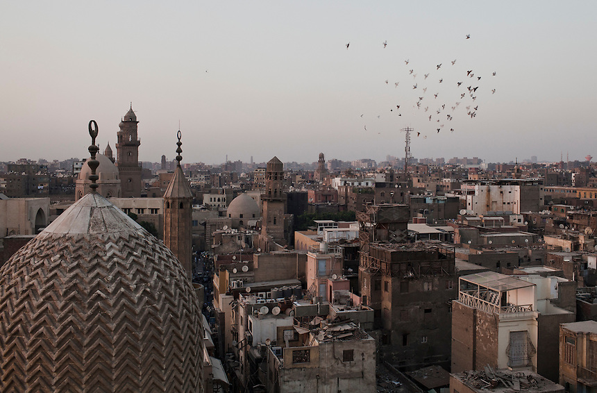A flock of birds flies above Cairo's Khan al Kalili market, one of the oldest areas of the Egyptian capital, June 2012. Photo: Ed Giles.