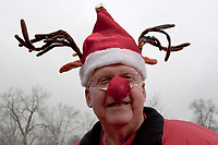 Chuck Jenkins, wearing a flashing red nose and a reindeer Christmas stocking hat, smiles as he enters Church of the Messiah in Westerville to join  others in his bell-ringing choirs they prepare themselves for an afternoon entertaining shoppers in a nearby mall.