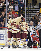 Brian Dumoulin (BC - 2), Patrick Wey (BC - 6), Steven Whitney (BC - 21) - The Boston College Eagles defeated the Northeastern University Huskies 7-1 in the opening round of the 2012 Beanpot on Monday, February 6, 2012, at TD Garden in Boston, Massachusetts.