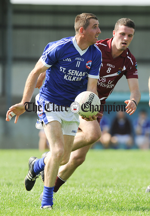 Barry Harte of Kilkee in action against Matt O Shea of Lissycasey during their Senior B county final at Cooraclare. Photograph by John Kelly.