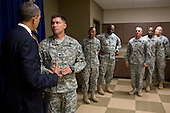 United States President Barack Obama talks with troops backstage before participating in a roundtable discussion at Fort Bliss in El Paso, Texas, August 31, 2012. The President traveled to Fort Bliss to mark the two-year anniversary of the end of America's combat mission in Iraq..Mandatory Credit: Pete Souza - White House via CNP
