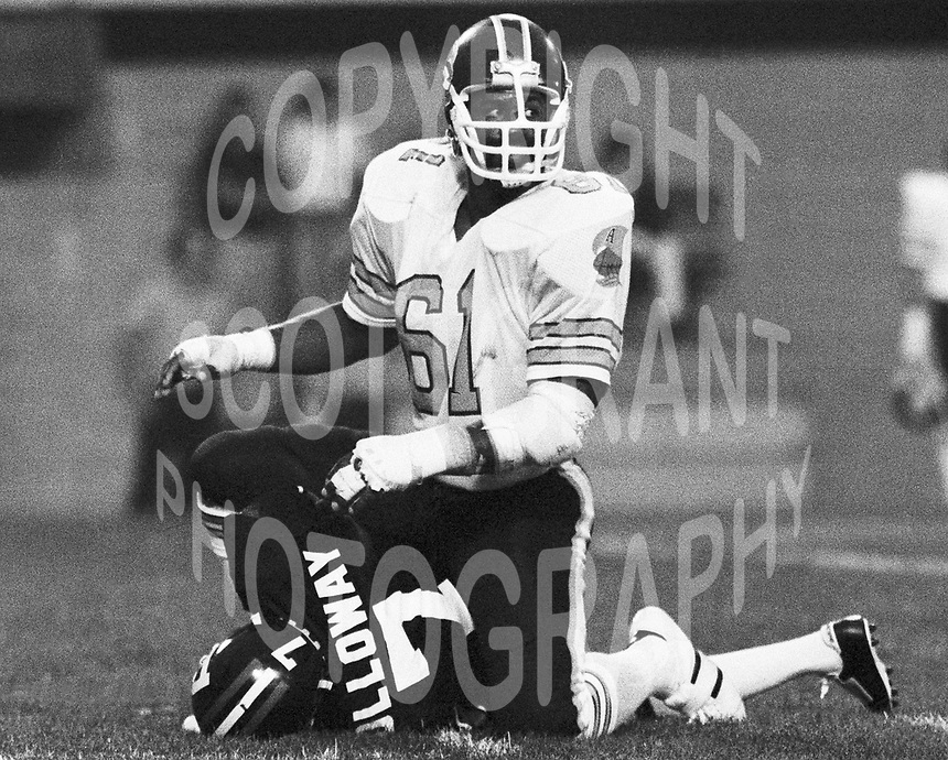 Bruce Smith Toronto Argonauts sacks Ottawa Rough Rider Quarterback Condredge Holloway. Copyright photograph Scott Grant