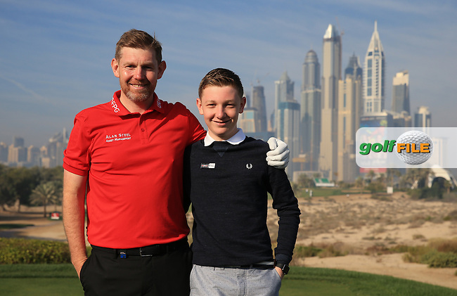 Stephen Gallacher (SCO) and son on the 8th tee during the Pro-Am at the 2016 Omega Dubai Desert Classic, played on the Emirates Golf Club, Dubai, United Arab Emirates.  03/02/2016. Picture: Golffile | David Lloyd<br /> <br /> All photos usage must carry mandatory copyright credit (&copy; Golffile | David Lloyd)