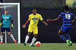 15 September 2015: UNCW's Matt Morgan (12) and Duke's Jeremy Ebobisse (19). The Duke University Blue Devils hosted the University of North Carolina Wilmington Seahawks at Koskinen Stadium in Durham, NC in a 2015 NCAA Division I Men's Soccer match. UNCW won the game 3-0.
